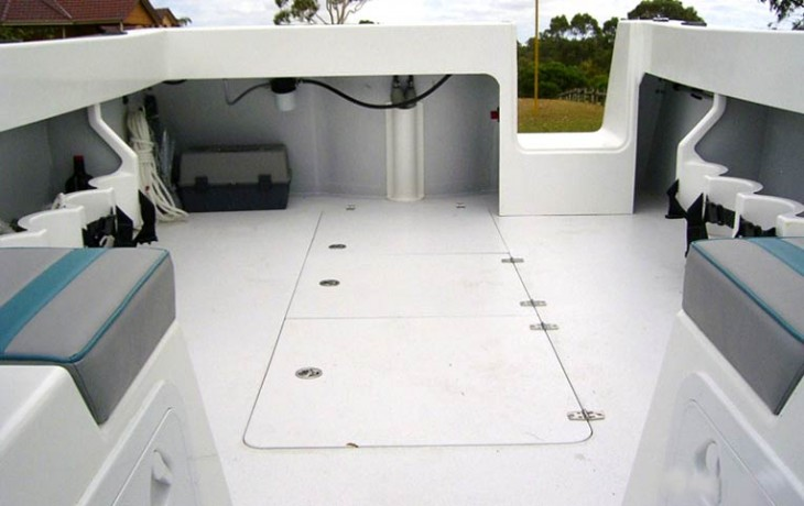 Aft deck of the Fibrelite Runabout, with hatches to the two underdeck fuel tanks and live bait tank