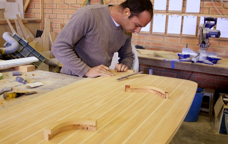 A Fibrelite craftsman builds a custom designed saloon table.