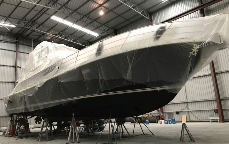 Salthouse 68 with superstructure masked to protect from dust as internal & external  modfications to the hull are undertaken.