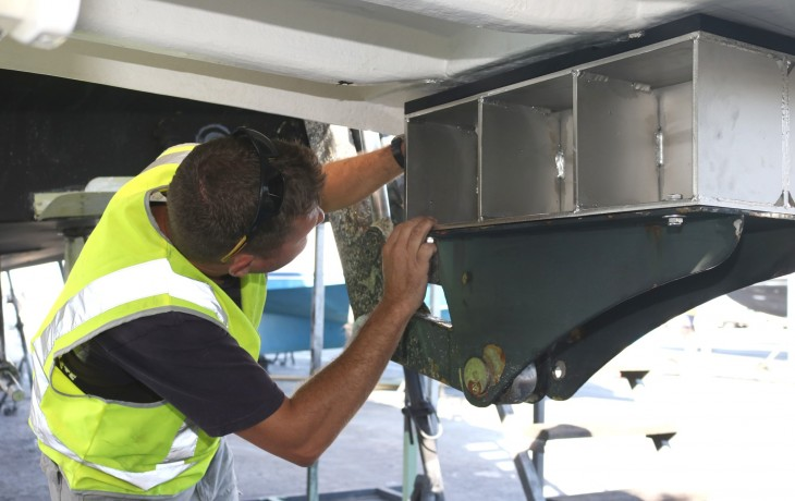 Inserting a spacer block to raise the marlin board of a Maritimo 52.