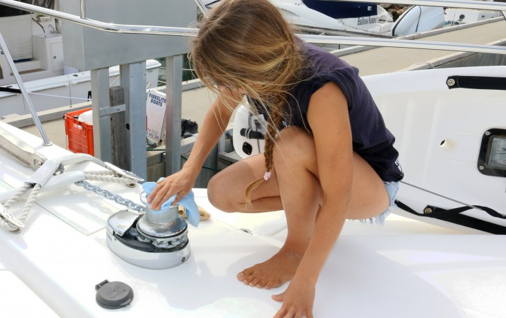 Carefully polishing the anchor winch