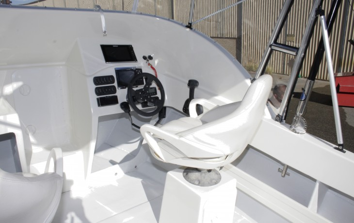 Helm station refit  completed;Cobia 580.