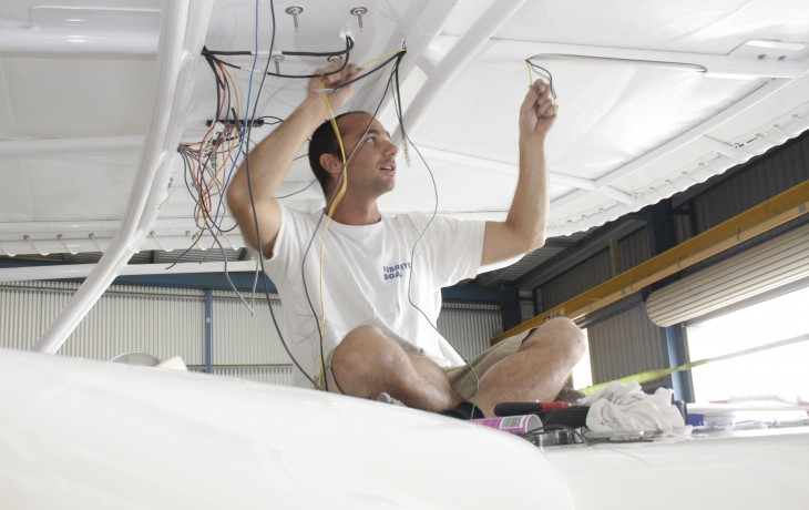 Reconnecting the wiring of the bimini after refurbishment, Midnight Express 40.