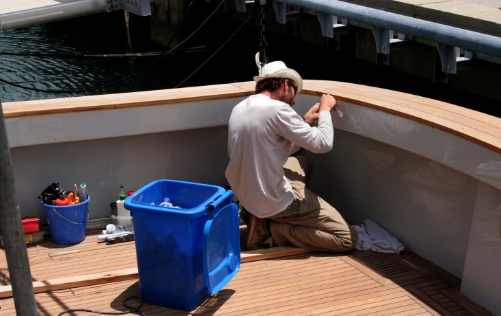 The final stages of teak deck repairs and covers replacement .