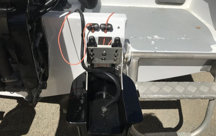 Beach launch installation of Furuno 200B-8B transducer in a Fibrelite fairing  - up position.