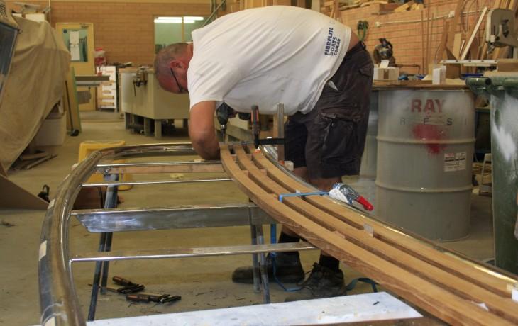 Work in progress teak and stainless steel marlin board.